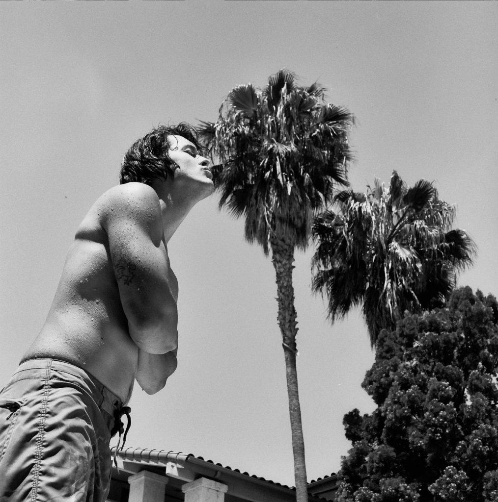 man kissing tree