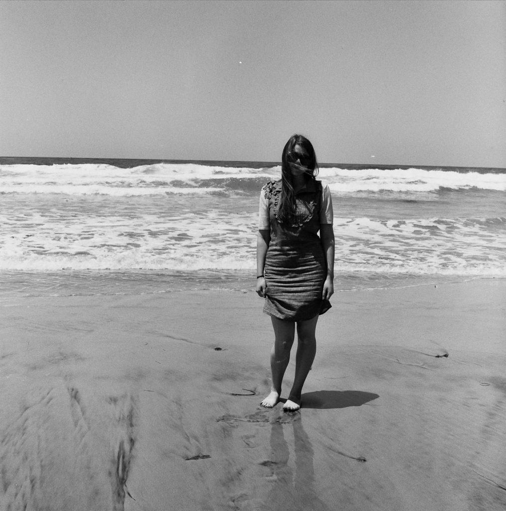 woman by pacific ocean