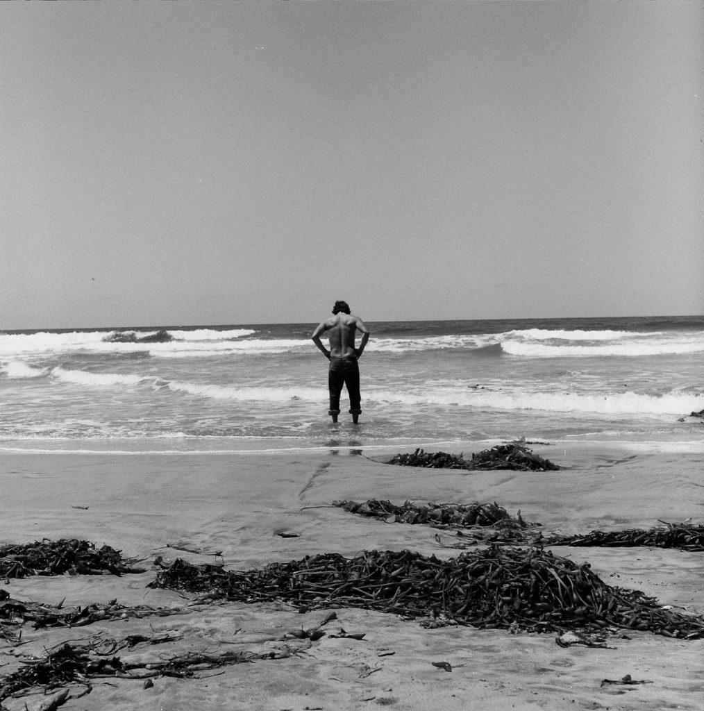 man looking at pacific ocean