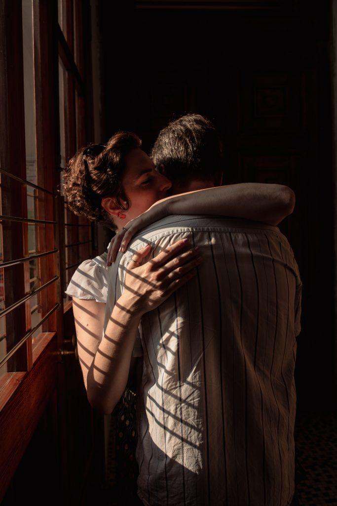 a couple embraces